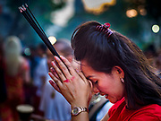 19 OCTOBER 2018 - BANGKOK, THAILAND: A woman prays during Navratri observances in Bangkok. Navratri is a nine night (10 day) long Hindu celebration that marks the end of the monsoon and honors of the divine feminine Devi (Durga). The festival is celebrated differently in different parts of India, but the common theme is the battle and victory of Good over Evil based on a regionally famous epic or legend such as the Ramayana or the Devi Mahatmya. Navratri is celebrated throughout Southeast Asia in communities that have a large Hindu population. Because Navratri honors the feminine Devi, Navratri is especially popular with Thai women and transgendered people.  PHOTO BY JACK KURTZ
