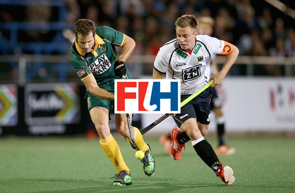 JOHANNESBURG, SOUTH AFRICA - JULY 13: Austin Smith of South Africa and Mats Grambusch of Germany battle for possession during day 3 of the FIH Hockey World League Semi Finals Pool B match between South Africa and Germany at Wits University on July 13, 2017 in Johannesburg, South Africa. (Photo by Jan Kruger/Getty Images for FIH)