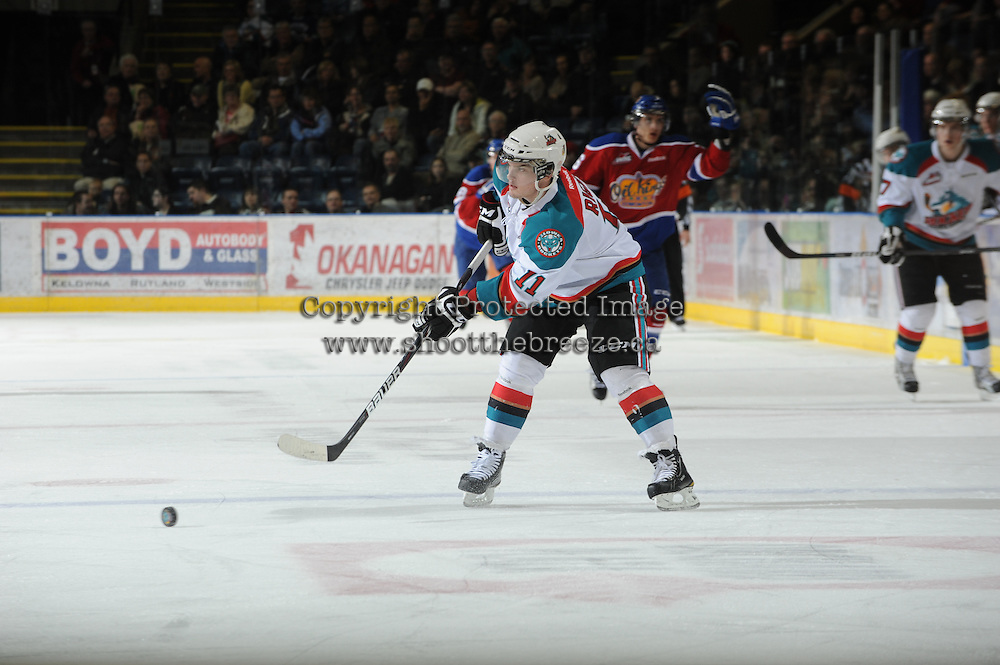 KELOWNA, CANADA, FEBRUARY 15: Carter Rigby #11 of the Kelowna Rockets makes a pass at the Kelowna Rockets on February 15, 2012 at Prospera Place in Kelowna, British Columbia, Canada (Photo by Marissa Baecker/Shoot the Breeze) *** Local Caption ***