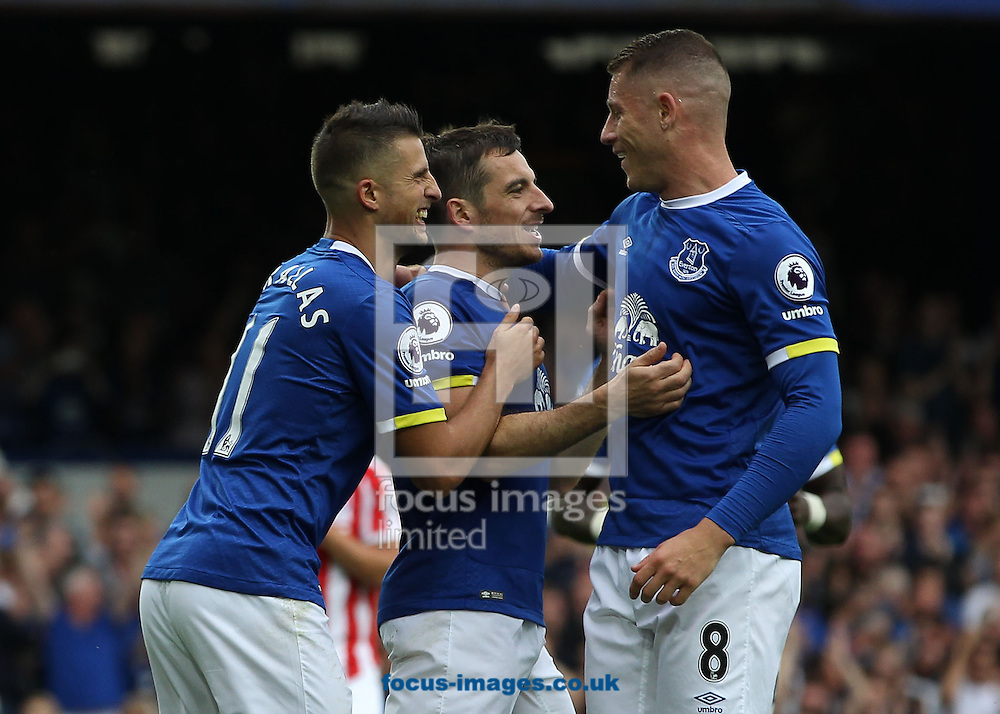 Leighton Baines of Everton celebrates with Kevin Mirallas and Ross Barkley after scoring the penalty goal against Stoke City during the Premier League match at Goodison Park, Liverpool.<br /> Picture by Michael Sedgwick/Focus Images Ltd +44 7900 363072<br /> 27/08/2016