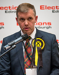 Pictured: Leith Walk Council By-Election. Edinburgh City Council, Edinburgh, Scotland, 11 April 2019. Pictured:  Rob Munn, Scottish National Party (SNP) candidate is announced as the elected council member. 25,526 residents are registered to vote in one of the most densely populated areas in Scotland under the Single Transferable Vote (STV) system. This is the first time in Scotland that an STV by-election has been needed to fill two vacancies in the same ward, held as a result of the resignation of Councillor Marion Donaldson. The election fielded 11 candidates, including the first ever candidate for the For Britain Movement in Scotland, Paul Stirling, founded by former UKIP leadership candidate Anne Marie Waters in March 2018.<br /> <br /> Sally Anderson | EdinburghElitemedia.co.uk