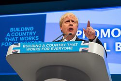 © Licensed to London News Pictures  . 03/10/2017 . Manchester , UK . Foreign Secretary BORIS JOHNSON delivers his keynote on day three of the Conservative Party Conference at the Manchester Central Convention Centre . Photo credit : Joel Goodman/LNP