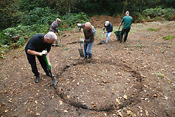 Ranger and volunteers at Bestwood Country Park, Nottingham, part of Sherwood Forest, working on conservation project; they are marking out areas in preparation for heather scrapes where the topsoil is removed and heather planted in order to produce heathland, a different habitat typical of the original forest. Removing the topsoil enables the heather to compete better against other plants species.