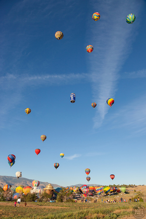 """Great Reno Balloon Race 12"" - Photograph of hot air balloons lifting off during the mass ascension at the 2012 Great Reno Balloon Race."