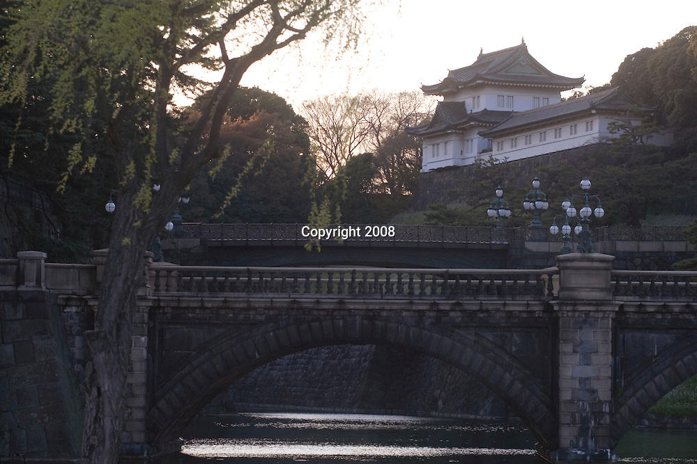 View in central Tokyo showing the entrance to the Imperial Palace at the Nijubashi twin bridges. Originally part of the Edo Castle, these twin bridges have been preserved as a symbolic gateway to Japan's Imperial Palace. Photo taken March 31, 2008.