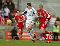 Photo: Ed Godden.<br />Leyton Orient v Carlisle United. Coca Cola League 2. 11/02/2006. <br />Carlisle's Paul Arnison (L) with Gary Alexander.