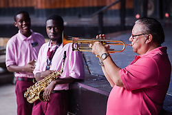 Ivanna Eudora Kean High School students Hezekiah George, left, and Sherwin Williams listen as Arturo Sandoval plays a tune on his trumpet.  Cuban Jazz trumpeter, pianist, and composer Arturo Sandoval plays alongside local high school and college musicians and answers questions about his life, inspiration, and performances at Reichhold Center for the Arts.  St. Thomas, USVI.  2 October 2015.  © Aisha-Zakiya Boyd