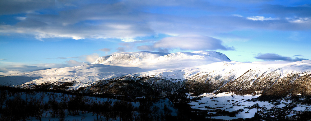 A view of Hallingskarvet Mountain and the Hardangervidda Plateau across Geilo in Norway.