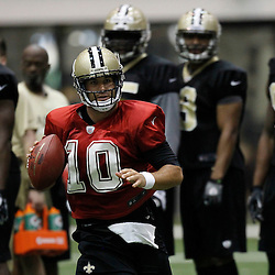 July 26, 2012; Metairie, LA, USA; New Orleans Saints quarterback Chase Daniel (10) scrambles with the ball during practice on the first day of of training camp at the team's practice facility. Mandatory Credit: Derick E. Hingle-US PRESSWIRE