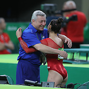 Gymnastics - Olympics: Day 6  Alexandra Raisman #395 of the United States is embraced by her coach Mihai Brestyan  after her Floor Exercise during her silver medal performance in the Artistic Gymnastics Women's Individual All-Around Final at the Rio Olympic Arena on August 11, 2016 in Rio de Janeiro, Brazil. (Photo by Tim Clayton/Corbis via Getty Images)