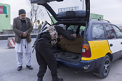 Dec. 18, 2018 - Herat, Afghanistan - An Afghan policeman searches a vehicle at a security checkpoint on the way leading to Shindand district of Herat province, Afghanistan. At least seven militants including two local leaders of the Taliban were killed as military aircraft targeted the militant group in Shindand district of the western Herat province on Monday, a statement of army said. (Credit Image: © Elaha Sahel/Xinhua via ZUMA Wire)