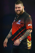 Michael Smith celebrates during the World Darts Championships 2018 at Alexandra Palace, London, United Kingdom on 29 December 2018.