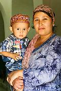 Uzbekistan, Samarqand. Mother with son.