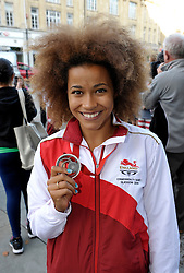 © Licensed to London News Pictures. 28/08/2014; Bristol, UK.  Jazmin Sawyers (Silver in Long Jump at the Commonwealth Games) at the Bristol sporting heroes parade for Commonwealth Games 2014 medallists and members of the England Womens Rugby World Cup winners.  The parade started at the Bristol Hawks Gymnastics Club in Easton, where 4 times Gold medal winner Claudia Fragapane trains, and went to Bristol CIty Hall.  Five of the eight Glasgow Commonwealth Games medallists have a Bristol connection:  Claudia Fragapane (4 Golds in gymnastics), David Luckman (Gold in shooting), Jazmin Sawyers (Silver in Long Jump), Gary Hall (Bronze in Judo), and Paul Brown (Bronze in para-lawn bowls).  Members of the England Womens Rugby World Cup team present were Amber Reed, Kay Wilson, Sophie Hemming, and Danielle Waterman.<br /> Photo credit: Simon Chapman/LNP