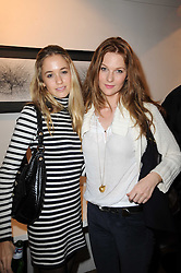 Left to right, sisters FLORENCE BRUDENELL-BRUCE and SOPHIE HORSLEY at a private view of Henry Brudenell-Bruce's work held at 269 Portobello Road, London, W14 on 24th November 2009.