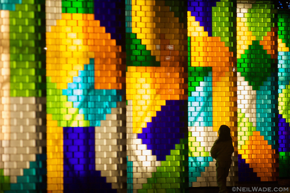 A small girl looks at a display of colorful blocks located at the base of Taipei 101 in Taipei, Taiwan.