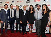"Producer Lorne Michaels, center, director Rhys Thomas, left, and Netflix Chief Content Officer Ted Sarandos, center left, are joined by ""Saturday Night Live"" cast members Colin Jost, Cecily Strong, Bobby Moynihan, left to right, and actress Gina Gershon, right, at the premiere of the movie Staten Island Summer at Sunshine Cinema, Tuesday, July 21, 2015, in New York.  The new comedy debuts on Netflix on July 30, 2015 and is available for Digital download. (Photo by Diane Bondareff/Invision for Paramount Pictures/AP Images)"