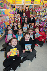 Caroline Sense of the National Literacy Trust and Adrian Scott Manager of WH Smiths Parkgate celebrating World Book Day at Parkgate Shopping Rotherham  with the help of teachers and Children from Rycroft School ..http://www.pauldaviddrabble.co.uk..1 March 2012 -  Image © Paul David Drabble