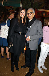 VIDAL SASSOON and his wife RONNIE at a party to celebrate the publication on 'A Year in My Kitchen' by Skye Gyngell held at The Petersham Nurseries, Petesham, Surrey on 19th October 2006.<br />