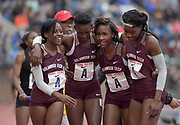 Apr 27, 2018; Philadelphia, PA, USA; Members of the Holmwood Tech girls 4 x 800m relay react after winning the Championship of America race in 8:48.33 during the 124th Penn Relays at Franklin Field. Team members include Delverna Bromfield, Brittney Campbell, Sasha Brown and Chrisanni May.