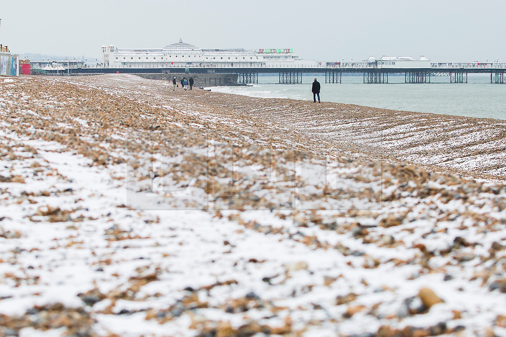 "© Licensed to London News Pictures. 18/03/2018. Brighton, UK. Brighton's Palace Pier and Brighton and Hove beach are covered in a layer of snow as a second ""Beast from the East"" is hitting the South Coast. Photo credit: Hugo Michiels/LNP"