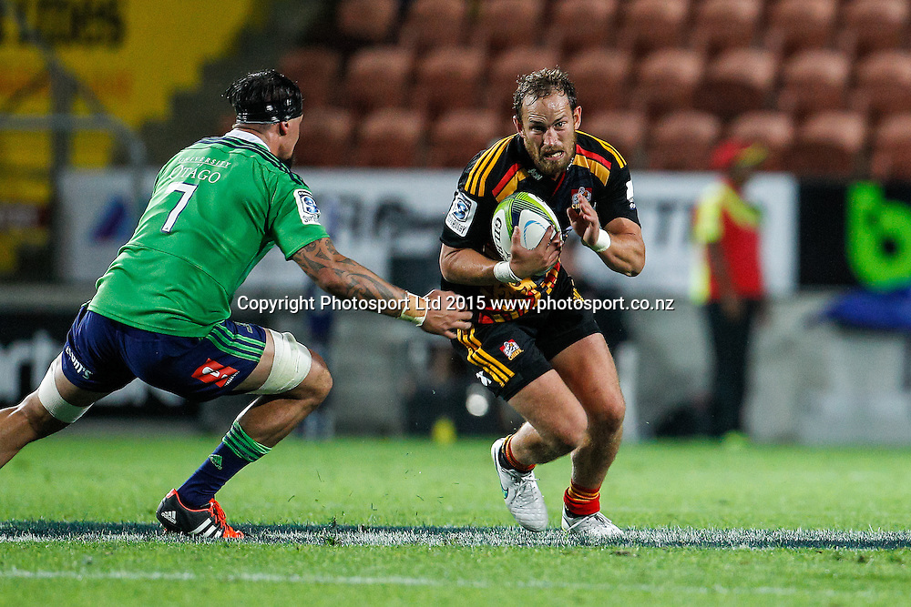 Chief's Andrew Horrell looks to beat the the tackle of Highlander's Elliot Dixon during the Super 15 Rugby Match - Chiefs v Highlanders, 6 March 2015 at Waikato Stadium, Hamilton, New Zealand on Friday 6 March 2015.  Photo:  Bruce Lim / www.photosport.co.nz