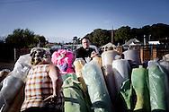 UNITED KINGDOM, Basildon :A resident talks to a priest next to a barricade  at Dael Farm camp on September 19, 2011  in Basildon, England.  © Christian Minelli..