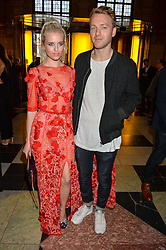 """KYLA LA GRANGE and DAVID PEARCE at a private view of Undressed: A Brief History Of Underwear"""" at the V&A, London on 13th April 2016."""