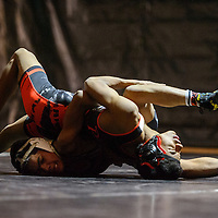 Gallup Bengal Primitivio Trevizo presses Grants Pirate into the mat Wednesday at Gallup High School.
