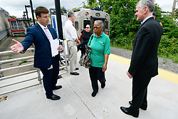 After departing the train Tropicana employee Renee Wilson, of Lindenwold, is one of the passengers helped with information about the upcoming temporary suspension for PTC installation on the Atlantic City Rail Line, at an information desk from NJ Transit, in Lindenwold, NJ, on Monday.