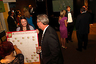 (from left) Misty Sayre of Dayton, Carrie Hawkins of Fairborn and Glenn Martin of Columbus during the 2013 Boonshoft Gala at the Boonshoft Museum of Discovery in Dayton.  The theme, Hip to be Square, is reflected in exhibits and demonstrations during the evening.