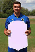AFC Wimbledon Tommy Wood holding Fifa sign during the AFC Wimbledon 2018/19 official photocall at the Kings Sports Ground, New Malden, United Kingdom on 31 July 2018. Picture by Matthew Redman.