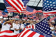 Fans of the U.S. team wave flags as the players are introduced before a CONCACAF Gold Cup soccer match against Panama in Kansas City, Kan., Wednesday, June 26, 2019. (AP Photo/Colin E. Braley)