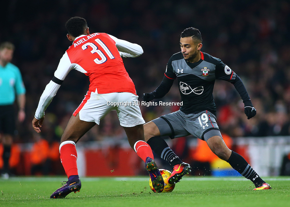 30.11.2016. Emirates Stadium, London, England. EFL Cup Football, Quarter Final. Arsenal versus Southampton. Southampton Midfielder Sofiane Boufal turns on the ball, as Arsenal Midfielder Jeff Reine-Adelaide looks to challenge