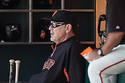 Bruce Bochy is sitting in the dugout during an MLB game between the San Francisco Giants and the San Diego Padres, at AT&amp;T Park in San Francisco, CA.<br /> The Giants won 13-8 in 9 innings.<br /> Credit : Glenn Gervot