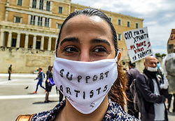 "A woman wears a protective facemask reading the message ""support artists"" as she takes part in a demonstration, in Syntagma Square in front of the Greek parliament in central Athens, on May 7, 2020 during a rally organised by artists, musicians and actors to ask for help to the Greek government for the financial loses due to the lockdown aimed at curbing the spread of the COVID-19<br /> <br /> Pictured: <br /> Dimitris Lampropoulos  
