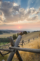 Classic log fence in ranch lands of Granite County Montana at sunset