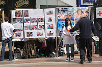 Grafton Street, Dublin, Ireland. The Irish red cross fundraising for the China earthquake appeal.