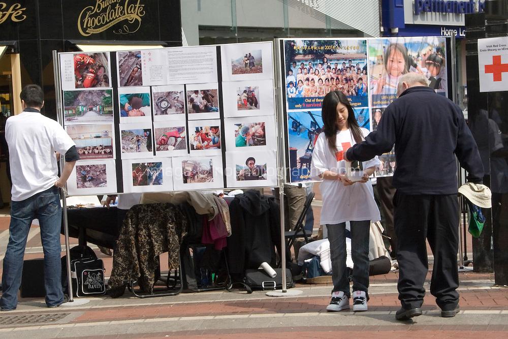 Grafton Street, Dublin, Ireland. The Irish red cross fundraising for the China earthquake appeal.
