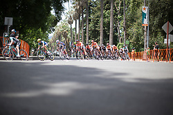 The peloton approaches a corner in the last quarter of the fourth, 70 km road race stage of the Amgen Tour of California - a stage race in California, United States on May 22, 2016 in Sacramento, CA.