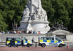© Licensed to London News Pictures. 24/05/2017. London, UK. Police patrol vehicles are seen next to the Queen Victoria Memorial opposite Buckingham Palace - security in the capital has been stepped up after the Manchester Arena bombing. The terrorism threat level has been raised to critical and Operation Temperer has been deployed. 5,000 troops are taking over patrol duties under police command. Photo credit: Peter Macdiarmid/LNP