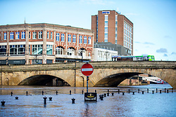 © Licensed to London News Pictures. 14/03/2019. York UK. The river Ouse in York city centre has continued to rise this morning flooding pavements, roads & some river side buildings after it broke its banks yesterday due to heavy rain from storm Gareth. Photo credit: Andrew McCaren/LNP