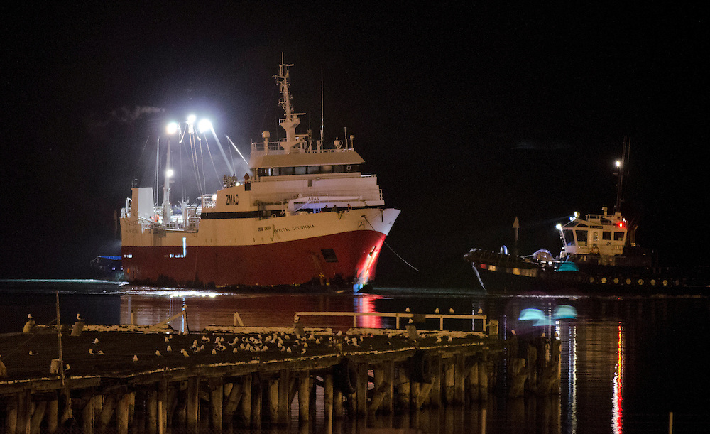 The fire stricken Amaltal Columbia is  towed into the inner harbour of Port Lyttelton by LPC tugs Blackadder and Purau after being abandoned at sea,  Lyttelton,  New Zealand,  Thursday 13 September, 2012. Credit: SNPA /  David Alexander.