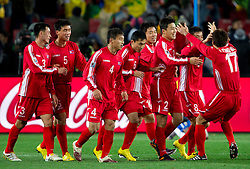 Players of Korea celebrate after Ji Yun Nam (8) scored during the 2010 FIFA World Cup South Africa Group G match between Brazil and North Korea at Ellis Park Stadium on June 15, 2010 in Johannesburg, South Africa. Brazil defeated Korea 2-1. (Photo by Vid Ponikvar / Sportida)