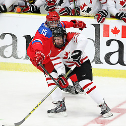 COBOURG, - Dec 19, 2015 -  Gold Metal Game - Russia vs Canada West at the 2015 World Junior A Challenge at the Cobourg Community Centre, ON. Cale Makar #7 of Team Canada West and Georgii Ivanov #15 of Team Russia battle for the puck during the first period.(Photo: Tim Bates / OJHL Images)