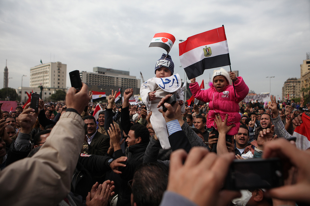 Protesters hold up their children at a protest at Tahrir Square calling for the ouster of Hosni Mubarak.