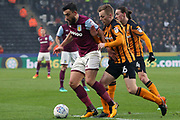 Aston Villa midfielder Robert Snodgrass (7) being marked by Hull City midfielder Sebastian Larsson (16)  during the EFL Sky Bet Championship match between Hull City and Aston Villa at the KCOM Stadium, Kingston upon Hull, England on 31 March 2018. Picture by Mick Atkins.