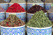 Assorted spice stand with aromatic and culinary herbs, spices and dried flowers in the Mellah, old Jewish Quarter, Marrakech, Southern Morocco, 2017-11-15.