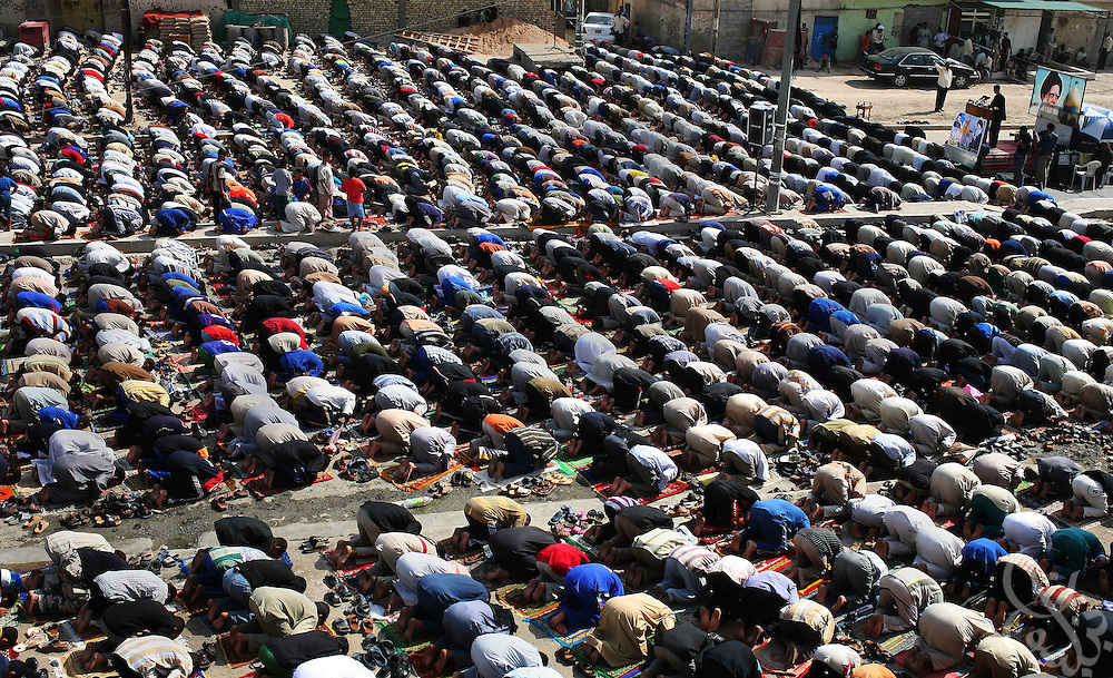 Supporters of Iraqi Shia cleric Moqtada al-Sadr gather for Friday prayers in the impoverished district of Sadr City in Baghdad, Iraq October 13, 2006.