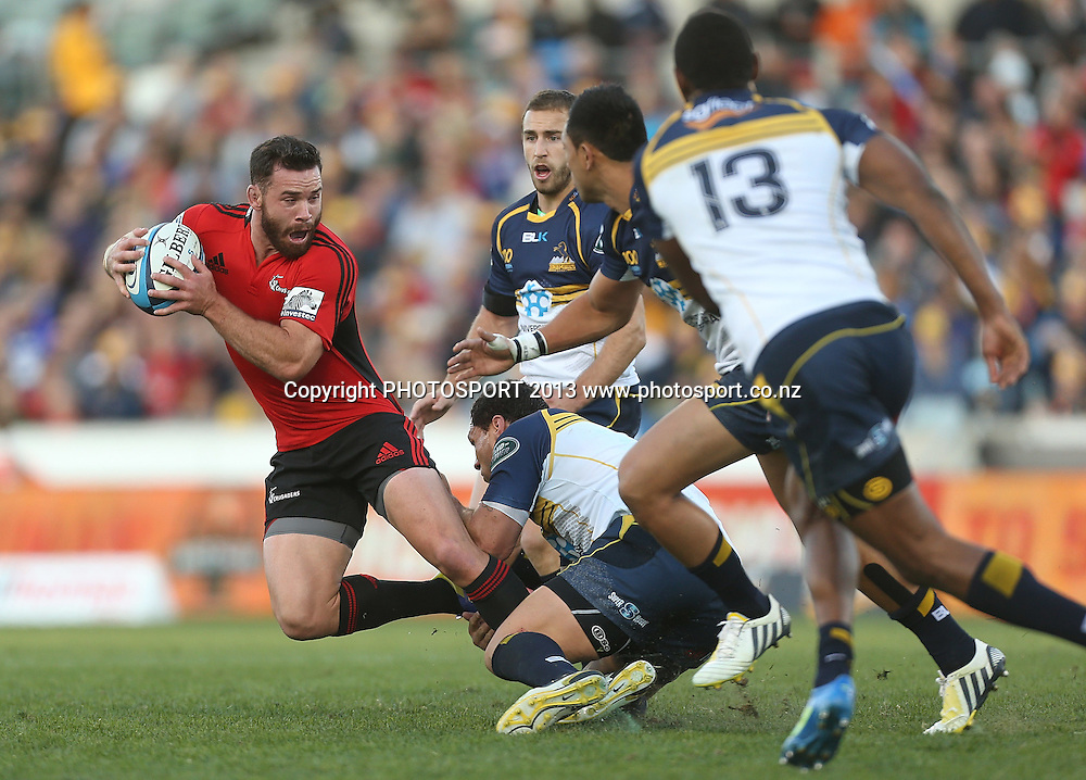 Crusaders' Ryan Crotty is tackled.  Brumbies v Crusaders. 2013 Investec Super Rugby Season. Canberra Stadium, Canberra, Australia.  Sunday 5 May 2013. Photo: Mark Metcalfe/Photosport.co.nz